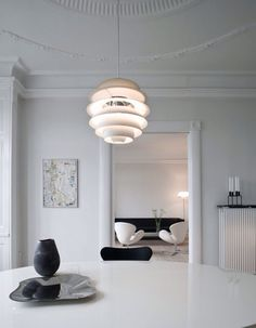 Poul Henningsen designed Snowball in 1958 and it was exhibited together with PH 5 at the Danish Museum of Decorative Art. Poul Henningsen designed Snowball in 1958 and it was exhibited together with PH 5 at the Danish Museum of Decorative Art. Interior Simple, Danish Interior, Scandinavian Interior, Minimalist Interior, Scandinavian Style, Diy Pendant Light, Pendant Light Fixtures, Pendant Lamp, Pendant Lights