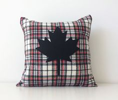Just in time for Canadas 150th year anniversary! This 16x16 sized cover on the front is made from a soft flannel in white, black and red, with a hint of yellow. I hand cut and carefully top stitched a maple leaf made of black eco felt on the front. Back of pillow is a