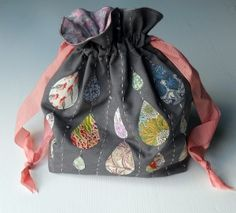 Drawstring bag with Liberty raindrops and sequins. This would be so cute on a pillow!
