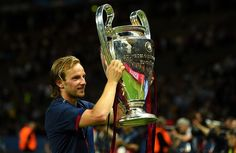 Ivan Rakitic of Barcelona holds the trophy as he celebrates victory after the UEFA Champions League Final between Juventus and FC Barcelona at Olympiastadion on June 6, 2015 in Berlin, Germany.