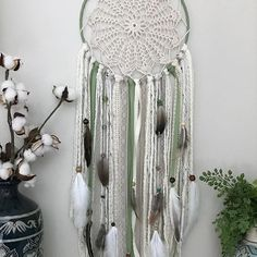 This is the first to feature one of the handmade doilies I received from Italy. Inspired by nature I used natural colors and olive green with lots of natural feathers I found locally. This one is and available now in my shop (only one available)