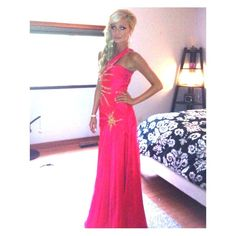 Size 2-4 Samila Backless Prom Dress with Slit Beautiful one shoulder Samila Prom dress with slit on rib cage and slit opening at the thigh. It is Hot Pink/Coral with gold and crystal embellishment. This dress is a showstopper. Wore it one time for prom. It's is in perfect condition. No stains, no snags, no tears. Just a tiny bit wrinkled from being stored in the closet. I would recommend steaming it. I am 5'7 and wore 4in heels in this dress. Can be hemmed to fit your length. Fits Dress Size…