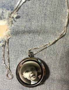 Creative idea: Custom photo behind metal plate in living locket (Origami Owl).. I chose a black & white to match the stainless steel. Photo taken by me.