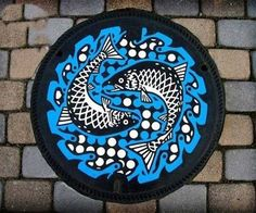 Japanese painted manhole cover, two fish. japan-13