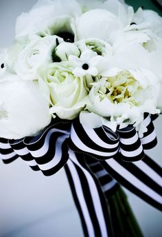 A simple striped ribbon adds tons of drama to this white bouquet.