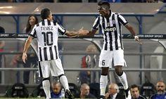 Juventus\' Pogba celebrates after scoring against Sassuolo during their Italian Serie A soccer match in Reggio Emilia