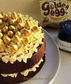 Golden Egg Chocolate Sponge Cake moist chocolate sponge with a thick layer of salted chocolate spread piped vanilla frosting and galaxy golden eggs.