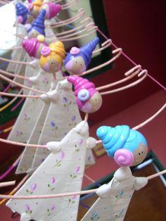 Bonecas em papel machê
