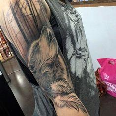 amazing howling wolf tattoo by Elvia at Adrenaline Vancity