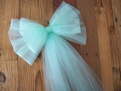 Tulle Pew Bow, grace and elegance at its best. CUSTOM CENTER EMBELLISHMENTS ALSO AVAILABLE> This beautiful pew bow will be an elegant, formal addition to your church or venue. Over 3 yards of quality tulle are used to make each double loop bow. This large impressive bow, measures approximately 15-16 inches wide and is 9 inches tall, bow is approx. 27 inches from top to bottom. Smaller top bow measures 11 inches wide and 8 inches tall. These measurements can be altered to fit your pews. A ...