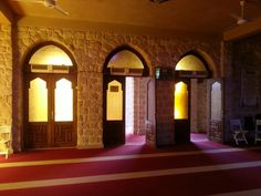 Three doors with yellow glass to the prayer hall