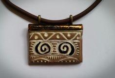 Ceramic pendant on rubber cord by Christine Gittins  www.christinegittins.tictail.com