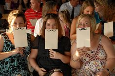 mustaches on the Backs of wedding Programs!! - Sarah Stein!!!! we have to do this!!