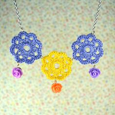 Pretty hand crocheted necklace with resin rose drops
