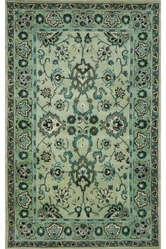 "Olivia Area Rug.  from little green notebook ""It would be so pretty layered on a large natural fiber rug in a living room."""