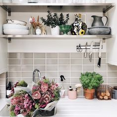 Simple neutral kitchen design. Metro tiles and open shelves in the kitchen via www.thishouseourhome.com