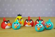 Fondant Angry Birds. Yes! they are edible. We make a home made marshmallow fondant that tastes good, for all of our cake decorations.
