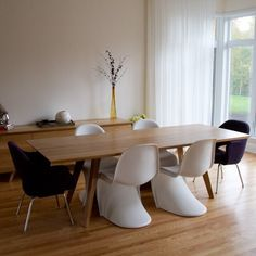 Wood tables offer the warmth and comfort for daily use and won't show regular wear and fingerprints easily. http://www.yliving.com/blog/choosing-best-dining-table-dining-room/