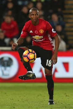 Manchester United's English midfielder Ashley Young controls the ball during the English Premier League football match between Swansea City and...