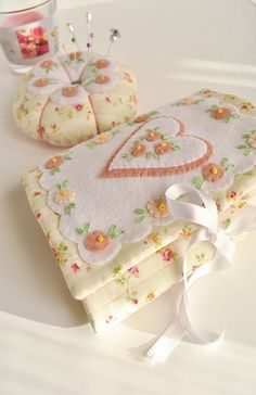 Sweet needle case and pincushion with felt embellishments.