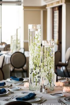 Beautiful Blooms Melissa Kelly Photography Starr Events Pyramid Club Submerged Flowers Tall Centerpiece Floating Candles Dendrobium Orchids Starr Events Crystals