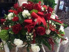 Red roses,gladiolus & bow with white carnation,monte casino & green dianthus & greenery