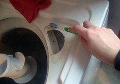 29. Clean out a top loading washing machine with vinegar, baking soda, and an old toothbrush.