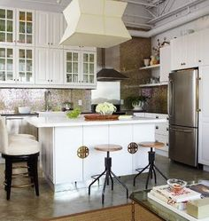 I love some of the glam details in this kitchen---especially on island and backsplash.