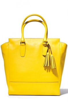 Legacy-tote like this Coach bag, I have this bag and love it   Lots of complements.  Its a day brightner.
