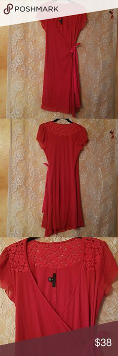 """ANTHROPOLOGIE WESTON WEAR DRESS RED SZ M Anthropologie Weston Wear Red Stretch Mesh and Lace Dress size Medium  Gorgeous dress in stretch mesh and lace in a vibrant orange red color! Faux wrap with side tie Pullover style Lace yoke with cap sleeves  Armpit to armpit- 17"""" Waist- 14"""" Hips- 18""""  Lots of stretch! Length- 37.5"""" Anthropologie Dresses Midi"""