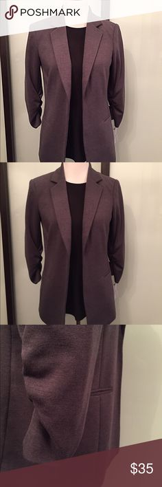Charcoal Jersey Blazer Bar III Crafted from a rich jersey blend, this jacket gets the balance between smart and casual just right. Tailored with an easy fit and gathered sleeve cuffs. Throw it on with denim for effortless chic. This jacket is lined. Original price $109.00. Bar III Jackets & Coats Blazers