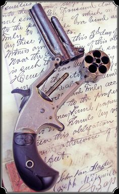 Marlin No. 32 Standard .32  Rimfire cal. Pocket revolver dated 1875. 5 shot with  3 inch barrel stamped No.32 Standard 1875 and on the  left side with J.M. Marlin, New Haven, CT. and with the 1873 patent date.