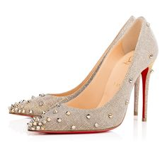"""The very sexy """"Degraspike"""" features a spike gradient from her pointed toe to her 100mm stiletto heel. In silver glittex and mixed metal spikes, she adds a strong dose of rocker chic to your wardrobe."""