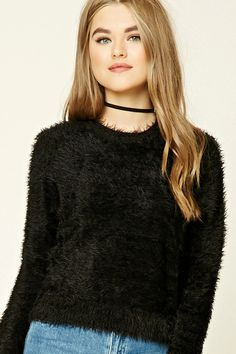 A fuzzy knit crop top featuring a round neckline, long sleeves, and a boxy silhouette.