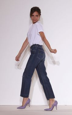 Victoria Beckham taking her bow in jeans after the show