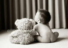 Adorable 6 month picture....not sure about the naked tushie. Could be cute with pants too