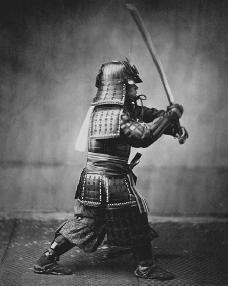 Samurai warrior, photographed c. 1860 by Felice Beato. Bushido, the samurai code of ethics, was formalized in writing in the sixteenth century and adhered to for some three hundred years. Bushido placed emphasis on certain chivalrous virtues such as loyalty, courage, and courtesy. © HISTORICAL PICTURE ARCHIVE/CORBIS