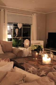 Cozy living room. Love the use of light and neutral colors.