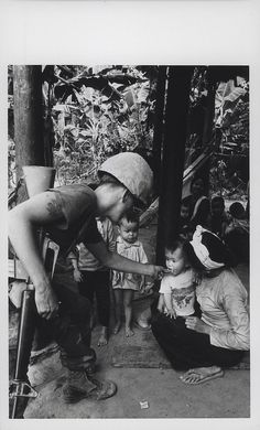 David Cook Shares Gum with a Vietnamese Child, 1969