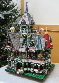 "This elaborate gingerbread house was created by John Lerner and was the first-place winner, adult category, in the Cleveland Botanical Garden's annual gingerbread house competition. It is titled ""Carson House, Eureka, Ca."" by kimberly Gingerbread Village, Gingerbread Decorations, Christmas Gingerbread House, Gingerbread Man, Gingerbread Cookies, Christmas Cookies, Gingerbread House Template, Gingerbread Recipes, Christmas Houses"