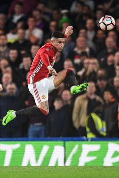 Manchester United's Argentinian defender Marcos Rojo clears the ball during the English FA Cup quarter final football match between Chelsea and...