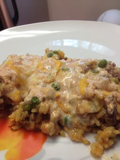Cheesy ground beef rice casserole. Add corn and Rotella instead of sauce