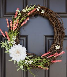 Natural looking Spring, Easter or Summer grapevine wreath with ivory burlap flower and coral accents by SimpleWreath on Etsy