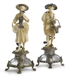 """FLOWER GATHERERS,"" A PAIR OF SILVER, ROCK CRYSTAL AND GEM-SET MOUNTED CARVED IVORY FIGURES, possibly French, circa 1900."