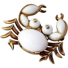 Trifari Crab Brooch, Alfred Philippe Design Vintage 1940's designer Trifari crab brooch featuring milk glass. On the underside of the brooch, it has the makers mark 'Trifari Pat. Pend'. This hallmark…MoreMore  #JewelryVintage