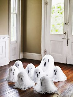 Tissue Paper Ghosts... This is so cute and SO easy... glue dots to stick contruction paper eyes and mouths onto white tissue-paper wedding bells, then drape them with cheesecloth @ Country Living