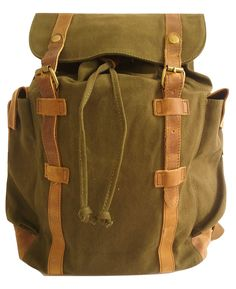 d3755323e2a Genuine leather straps and a drawstring closure gives this backpack a  vintage feel. This bag
