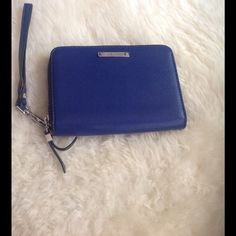 Stella & Dot blue wallet Used once. Decided it was not for me.  Like new. Spacious and can fit a lot of cards and $.  Vegan leather. Stella & Dot Bags Wallets