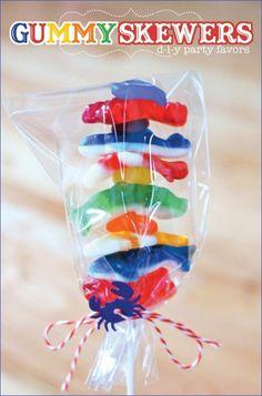 Gummy Shark skewers.  Good party favor.  Gummy lifesavers between sharks.   Cute!