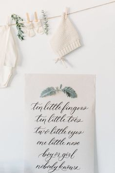 Neutral baby shower ideas   Gender neutral baby shower   100 Layer Cake. Here's an example of how a little goes a long way—there's just so much elegance in the simplicity and soft colors of this neutral baby shower theme. Not much of greenery was needed to help this beautiful calligraphy sign stand out. #babyshowerideas #babyshowerthemes